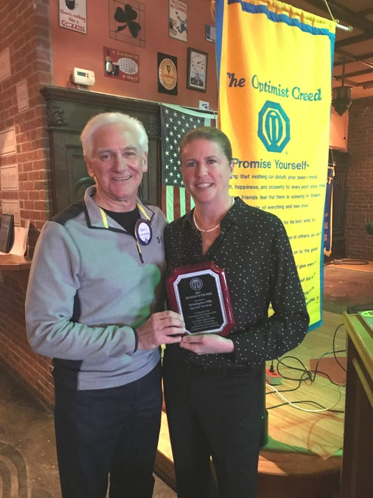 Ellen Schnackel Accepts Optimist Club Award