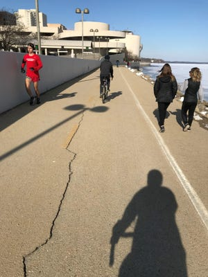 I believe if you ride a bicycle on the pathway that runs along the Frank Lloyd Wright-designed Monona Terrace in Madison, you are legally obligated to take a photo.