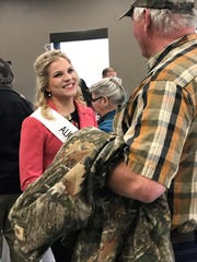 Alice in Dairyland Crystal Siemers-Peterman chats with guests during a reception was held following the introduction of candidates for the 71st Alice in Dairyland at the Farm Operations Technology & Training Center of Heartland Farms in Adams County.