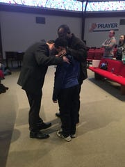 Pastor Jeff Parker and Outreach Coordinator Willie Cox minister to a young congregant at Southside Baptist Church.