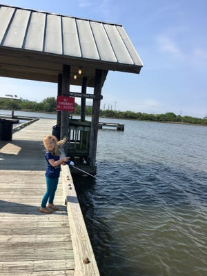 Avery Guidry, 3, fishes from a pier at Grand Isle State Park.