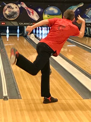 Pleasant's Bobby Davis tries to pick up a split during a match against Marion Harding this season at bluefusion entertainment. Sparks, who made the state tournament in Division II, was named MOAC Boys Bowler of the Year.