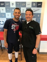 Minnesota Twins outfielder Eddie Rosario and Fort Myers dentist Ricardo Bocanegra worked together in bringing help to their native Puerto Rico after Hurricane Maria.