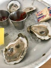 Raw oysters with cocktail sauce and a cucumber mignonette