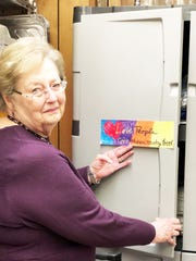 Nancy Griffith, one of the Martha's Kitchen organizers, checks on meal packaging supplies.
