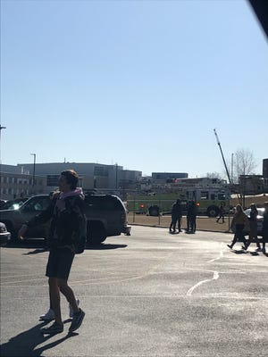 Parent Courtney Bandomir captured this view of emergency vehicles and students outside Oconomowoc High School on March 22 when she went to the school to pick up her child. The school was evacuated after students reported feeling ill.