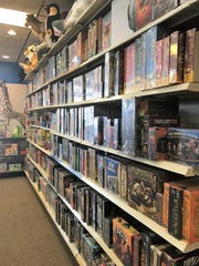 A wall lined with board games at Specialties Games,