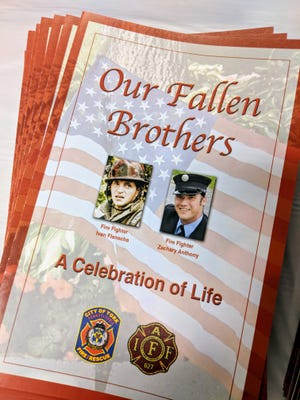 A stack of programs for the memorial service honoring fallen York city firefighters Ivan Flanscha and Zachary Anthony.