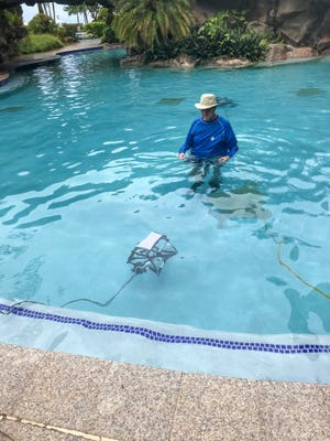Kelly Fitzpatrick of Our Lady of Academy working on their teams underwater robot.