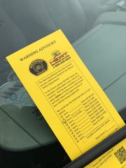 Warning advisories were left on cars parked near Comerica