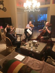 The Cliffrose String Quartet practices in preparation for the final concert of the Cliffrose Chamber Music Series on April 29 in Mesquite.