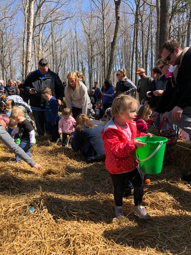 Kids play at the Easter egg hunt at White Horse Park