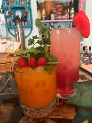 A Jackrabbit Quick (right) gets its color from carrot juice and a kick from pepper-infused tequila. Not Just Another Tequila Sunrise is made with hibiscus syrup.