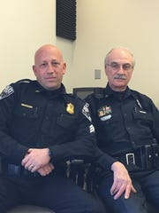 Milford Police Sgt. Ed Pilch (left) and retired Lt.