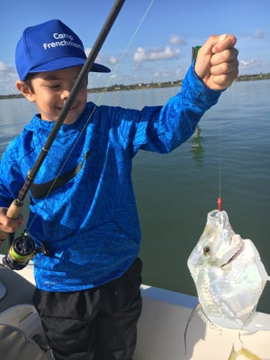 Eli with his favorite fish of the day! He caught this moon fish while fishing with Grandpa Don!