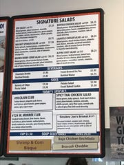 One of the menu boards at Roly Poly highlights daily