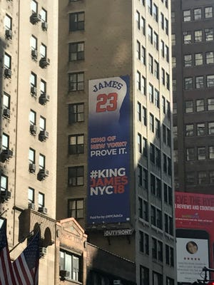 An ad advocating for LeBron James to sign with the Knicks this summer hangs near Madison Square Garden.