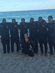 Hughes' academic advisor Caitlin Vagades with Bryan Wyant and the coaching staff in Florida.