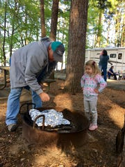 """Jay Guidry cooks """"camper stew"""" on a campfire with granddaughter"""