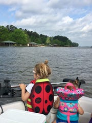 Sisters Avery and Marie Guidry enjoy boating with on Lake Claiborne.
