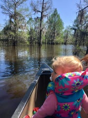 Marie Guidry, 1, captains the boat during a ride on Lake Bistineau.