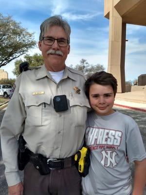 Taylor County Deputy Bob Bailey enjoys a visit from his grandson, Jim Grund.