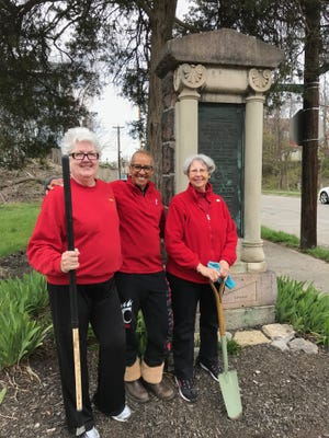 Members of the Cincinnati Chapter of Daughters of the American Revolution — Gretchen Wilson, from left, Michelle Wherry and Kathryn Mereness — keep the Ludlow monument in Northside tidy.