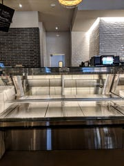 The empty meat counter at the Falls City Market inside the Omni Hotel, 400 S. 2nd St.