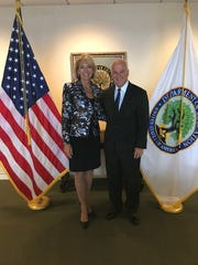 Ave Maria President Jim Towey stands with Education Secretary Betsy DeVos in Washington, D.C., on April 3, 2018. Towey's invitation to DeVos to speak at the university's graduation in May has elicited opposition from Ave Maria alumni.