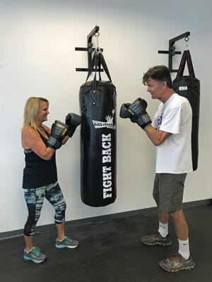 Fitness Trainer Janice Moia of Advance Fitness in Melbourne takes client Jeff Wallace through a session of Rock Steady Boxing. Moia will discuss the benefits of the Rock Steady Boxing exercise program at Parkinson's: Health, Hope & Happiness in Melbourne on April 26.