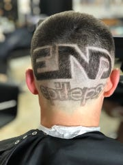 """Loren Zitomersky had """"end epilepsy"""" shaved into his head before race day in Boston."""