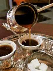 Turkish coffee is a thick, dark brew made by heating finely powdered coffee in boiling water with sugar, then pouring into tiny cups. The sediment is permitted to settle before the coffee is sipped.