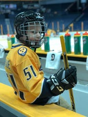 Devin Roque, who has autism and is battling a rare form of cancer, gained energy in his fight from a visit with the Predators last month -- and Austin Watson even let him wear No. 51. John Russell/NHLI