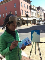 Mac Carr of Stuart Hall School was one of dozens of painters on the streets of Staunton Friday, April 20, 2018.