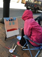 Eva Walters of Harrisonburg joined her mother on Beverley Street in Staunton to paint the downtown scenery on Friday April 20, 2018.