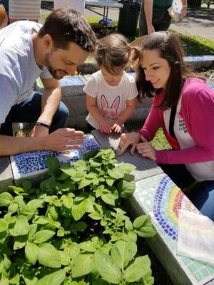Saint Paul's UMC Associate Pastor Matt Kern, with his wife Jen and daughter Madison, in the Saint Paul's garden.