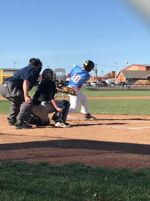 Ridgedale batter Myles Nutter gets a hit against Colonel Crawford during Friday's 10-4 home win for the Rockets.