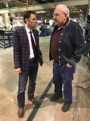 Sixth district Congressional candidate Johnathon Lamb speaks with local business owner Charlie Shaw during a visit to his casket factory.