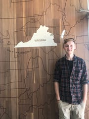 "William Ennis stands in front of the map of Virginia in the newly renovated McDonald's in Onley last week. After noticing the Eastern Shore missing from the map, he created a stencil to complete the Commonwealth. The panel has since been removed ""in hopes that the replacement (including Virginia's Eastern Shore) will come soon,"" said Tiffany Beach, owner and operator the restaurant."