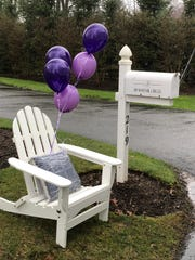 "The all-weather chairs given to residents of Wayfair Circle to celebrate ""Way Day"" proved their merit as rains continued throughout the morning."