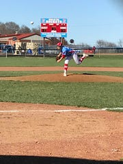 Ridgedale sophomore Nate Blevins delivers a pitch Friday