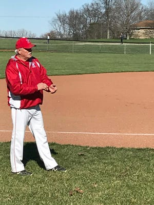 Ridgedale head baseball coach Lanny Martin delivers a sign to a batter Friday afternoon against Colonel Crawford. The Rockets were 2-22 last year, but this season they are already 11-3.