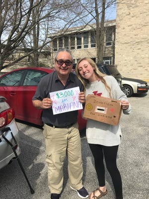 Indiana University freshman Becca Richter helped raise more than $8,000 to help pay for a surgery for Mariana, the daughter of residence hall cashier Oscar Arreaza.