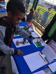Eli Thomas, age 8, of Basking Ridge explores Bricks