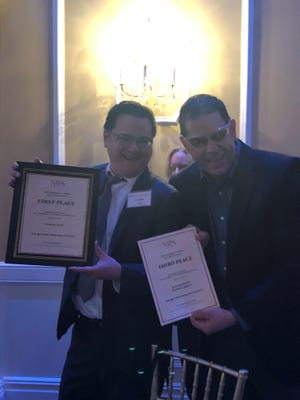 Staff writer Curtis Tate and Senior Director for Investigations Dan Sforza pose with awards at the NJPA Awards dinner at the Hamilton Manor in Hamilton Township on April 26.