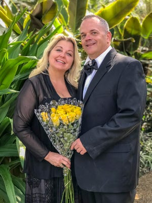 John David Thompson of Pella and Heather Steele of Denver, Colorado, pose for photos Friday, April 27, 2018, at the Greater Des Moines Botanical Gardens.