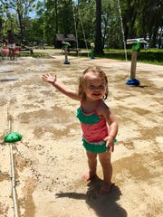 Marie Guidry plays at the splash pad at Lake Bruin