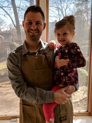 Chris Kopek holds his daughter Lilly, for whom his company, Lirio Chocolate, is named.