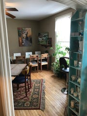 Cozy rooms in the renovated house creates intimate settings to sit and talk over coffee at 5th And Jefferson Coffee.