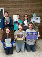 "Sheboygan Falls High newspaper ""The Talon"" is back in the game at NEWSPA. Back row: Matt Herr, Mary Hammarlund, Jessica Leicht, Lauren Luedtke Second row: Amber DeFere, Erin Kisiolek, Jack Leibham."